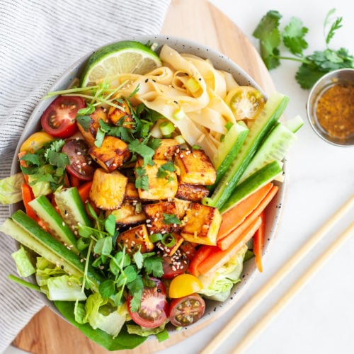 One of the best healthy Thai salad recipes you'll try! With a delicious spicy lemongrass dressing (the tastiest of dressings!), rice noodles, crunchy cucumber, carrots, chopped cilantro, and crispy tofu (sub for chicken, beef, or shrimp if you don't want vegan!). This salad is easy to make and perfect for any day of the week!
