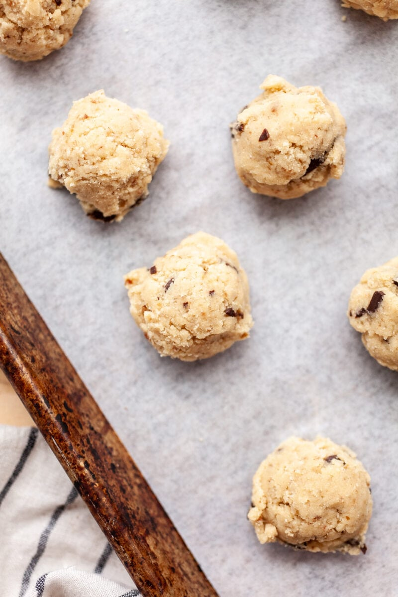 Raw Soft & Chewy Coconut Flour Chocolate Chip Cookie Dough Portions on a cookie tray