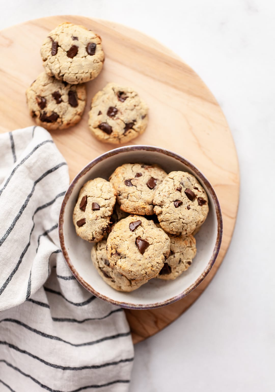 Soft & Chewy Coconut Flour Chocolate Chip Cookies In a Bowl on a Wood Platter