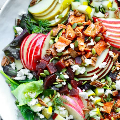 This delicious fall harvest chopped salad is wonderfully simple, loaded with healthy ingredients and topped with an easy and tasty almond dijon apple dressing. Whether it's for Thanksgiving, for parties, for a crowd, or just for yourself at home, this dairy free, gluten free salad is a must for fall.
