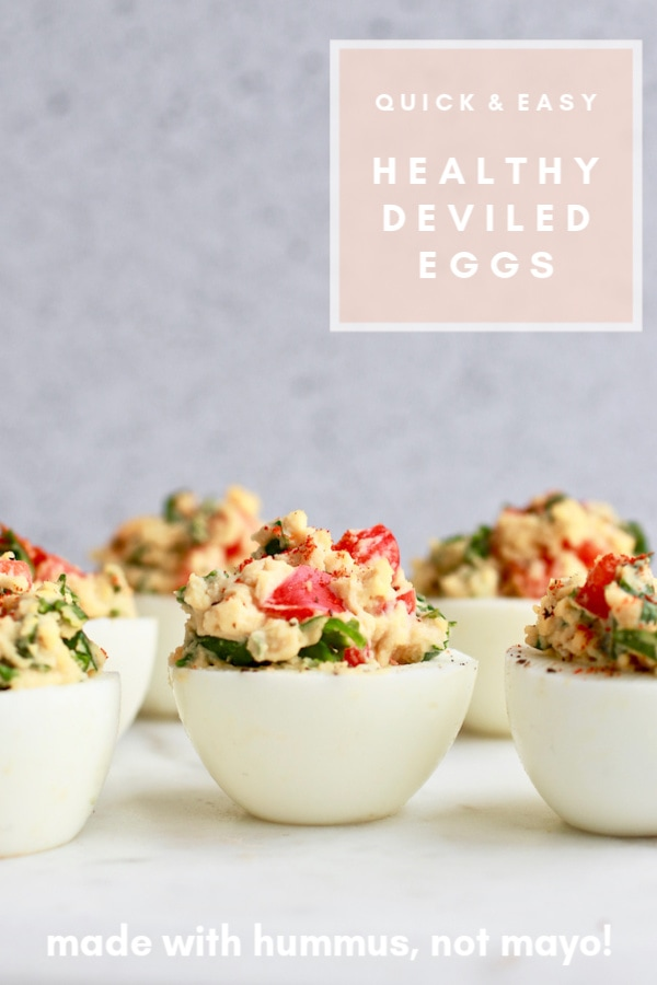 This healthy deviled eggs recipe is a perfect clean eating snack idea made healthier as hard-boiled eggs are filled with hummus (no mayo!) and added veggies! These tasty snacks are easy and quick to make and dairy free and gluten free too!