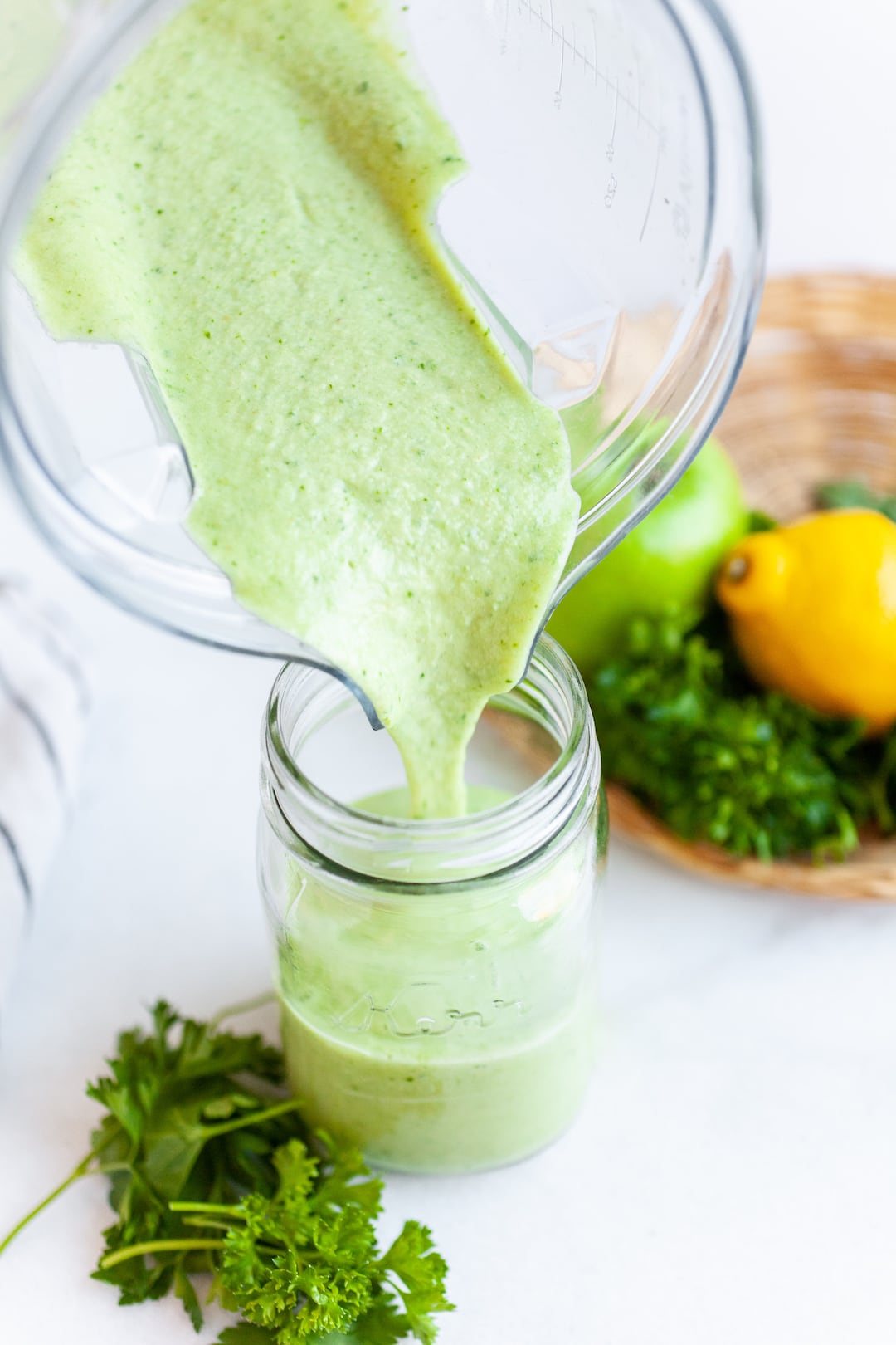 Pouring Best Ever Parsley Smoothie Recipe into a Jar