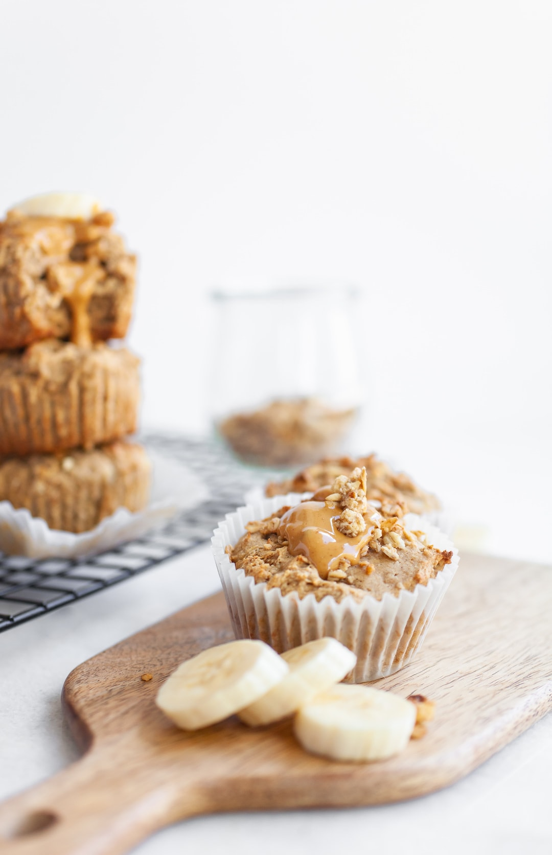 banana muffins on a wood tray with banana slices