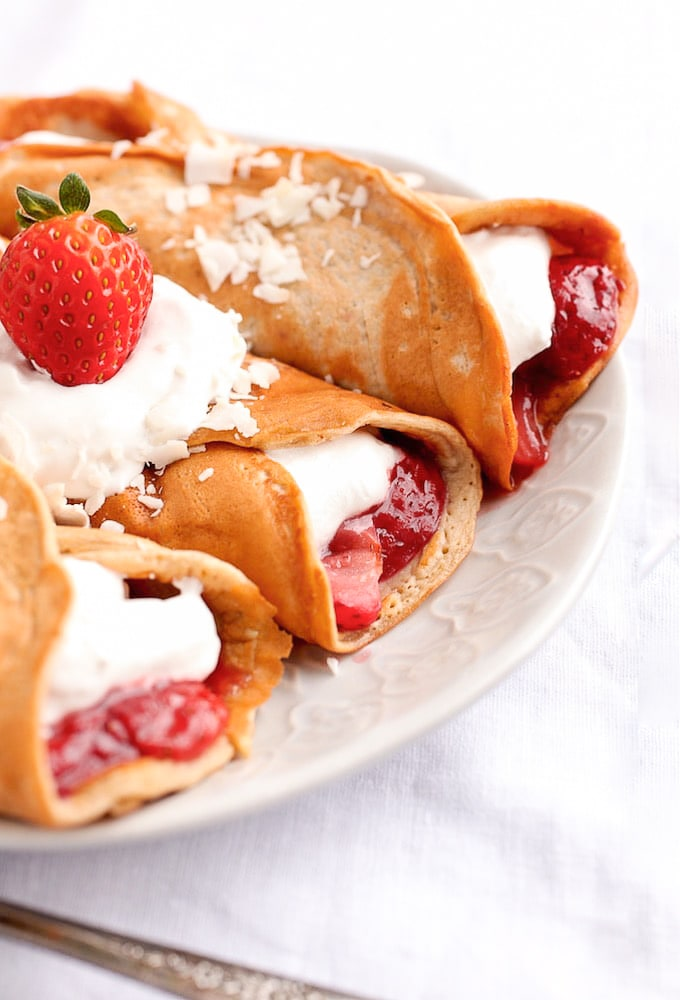 close up of Healthy Protein Crepes with strawberry and coconut whipped cream filling