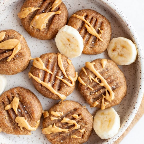 Healthy Peanut Butter Banana Cookies with a drizzle of peanut butter