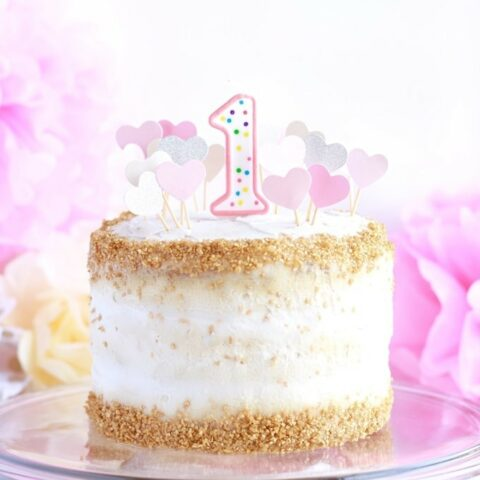 This delicious and healthy smash cake recipe is great for a baby first birthday. The homemade cake works for a boy or girl depending on your final decorating and is super easy to whip up. It's made with banana, carrot, vanilla, coconut, and is low sugar, dairy free, and gluten free too!
