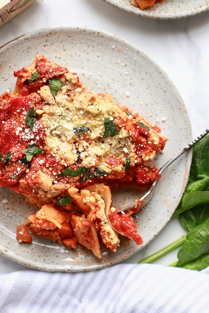 This delicious and easy lasagna recipe is made healthy with plant-based veggie ground and a simple cashew spinach ricotta! It's vegan and vegetarian but has a classic lasagna taste, sure to please any lasagna lover!