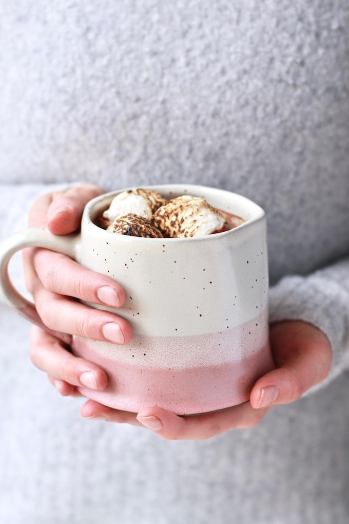 This delicious, homemade healthy hot chocolate recipe is perfect for the winter season. It's made with nourishing ingredients, fortified with iron, and naturally dairy free and paleo. It can easily be made vegan and is the best healthy version of hot cocoa you'll try!