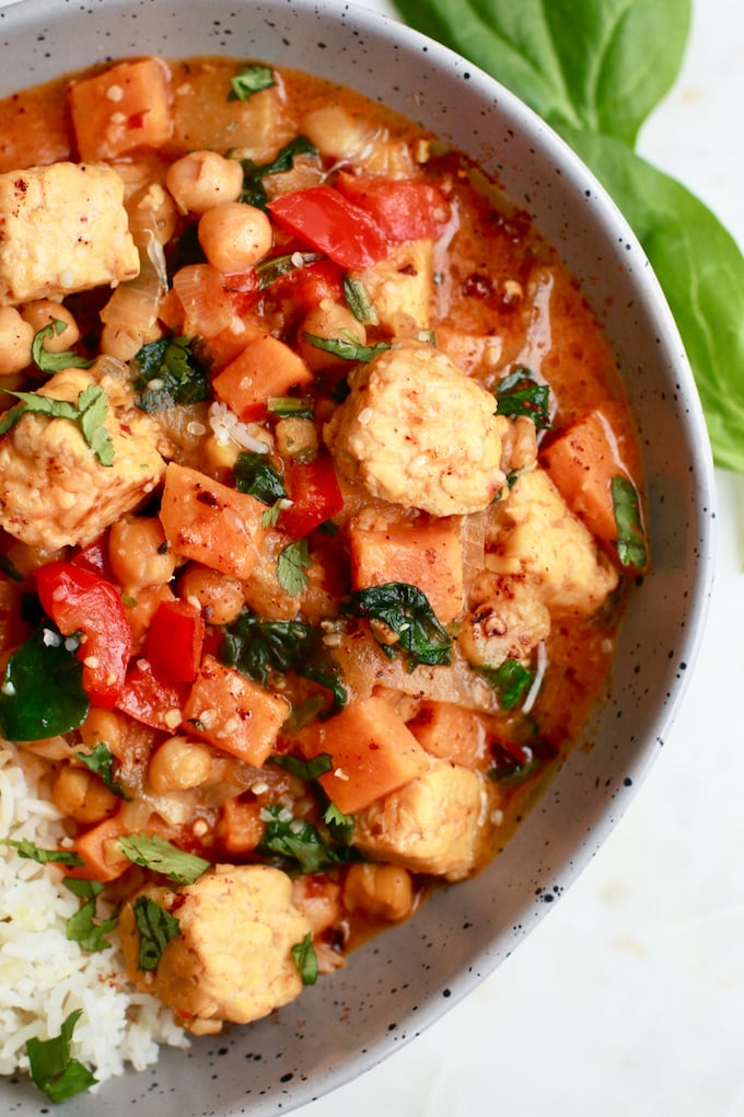 This delicious and easy recipe for Thai Red Curry stew is so perfect for any day of the week. It's vegetarian, can be easily made vegan, full of vegetables and tempeh and made with coconut milk. It's also gluten free, can be served with rice, quick and simple…less than 30-minutes to dinner!