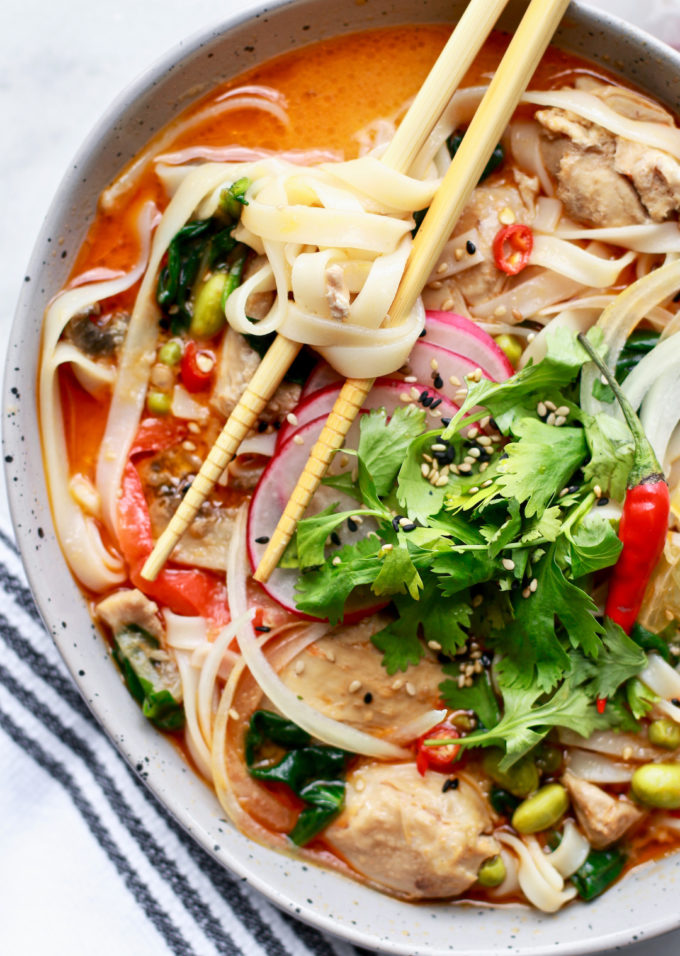 This delicious and easy Thai chicken soup recipe with coconut and rice noodles is healthy, slightly spicy, dairy free, and gluten free made in just 15-minutes in the crockpot express crock pressure cooker (it's a slow cooker too!). Full of spring vegetables and super nourishing, enjoy this soup even as the weather gets warmer!