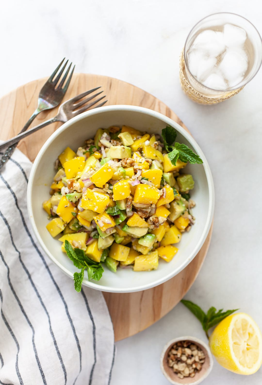 Easy Mango Avocado Salad overhead view in a bowl with forks on the side