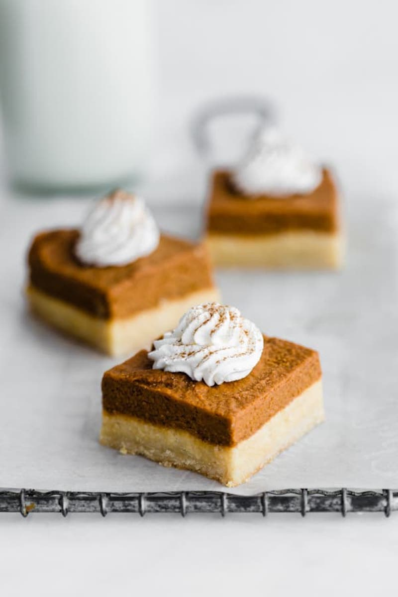 9 Drool-worthy Gluten Free, Dairy Free Pumpkin Pie Recipes - Pumpkin Pie Bars with Almond Cookie Crust from Choosing Chia