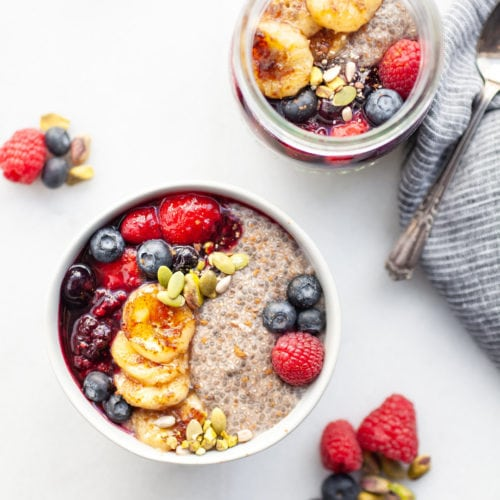 This delicious warm chia pudding is the recipe of all recipes! It's a healthy breakfast, snack, or even dessert idea made with almond milk, vanilla, cinnamon, caramelized banana, and warm berry compote. Enjoy in a bowl or in mason jars, you'll love the taste of chia pudding that warms you up from the inside out!