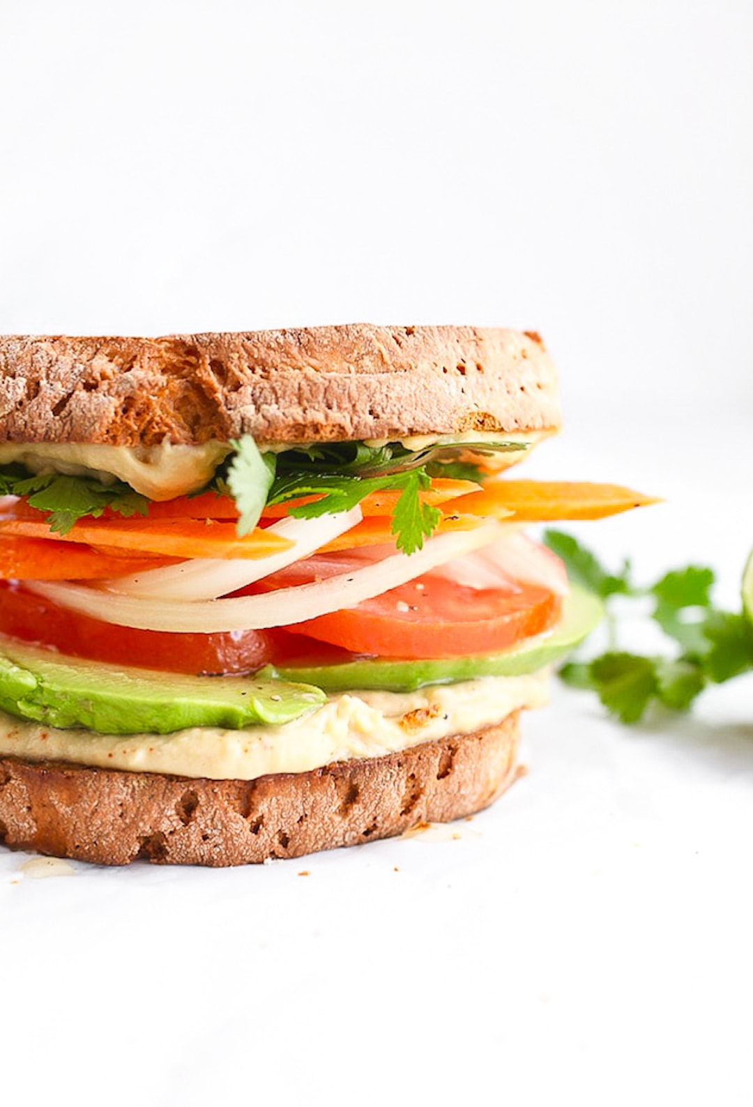 11 Yummy Plant Based Sandwiches - Avocado & Spiced Hummus Sandwich by Nutrition in the Kitch