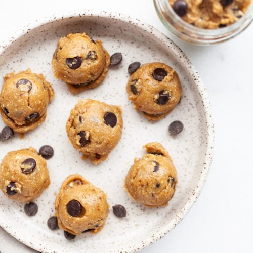 This delicious and healthy edible vegan chocolate chip cookie dough recipe is so easy to make it takes just 5-minutes. It can be enjoyed for one or for two with a spoon or as a dip for apples or other fruit! It's made with no milk, no flour, no butter, and it's egg free so it's safe to eat raw. Grab a spoon and dig in!