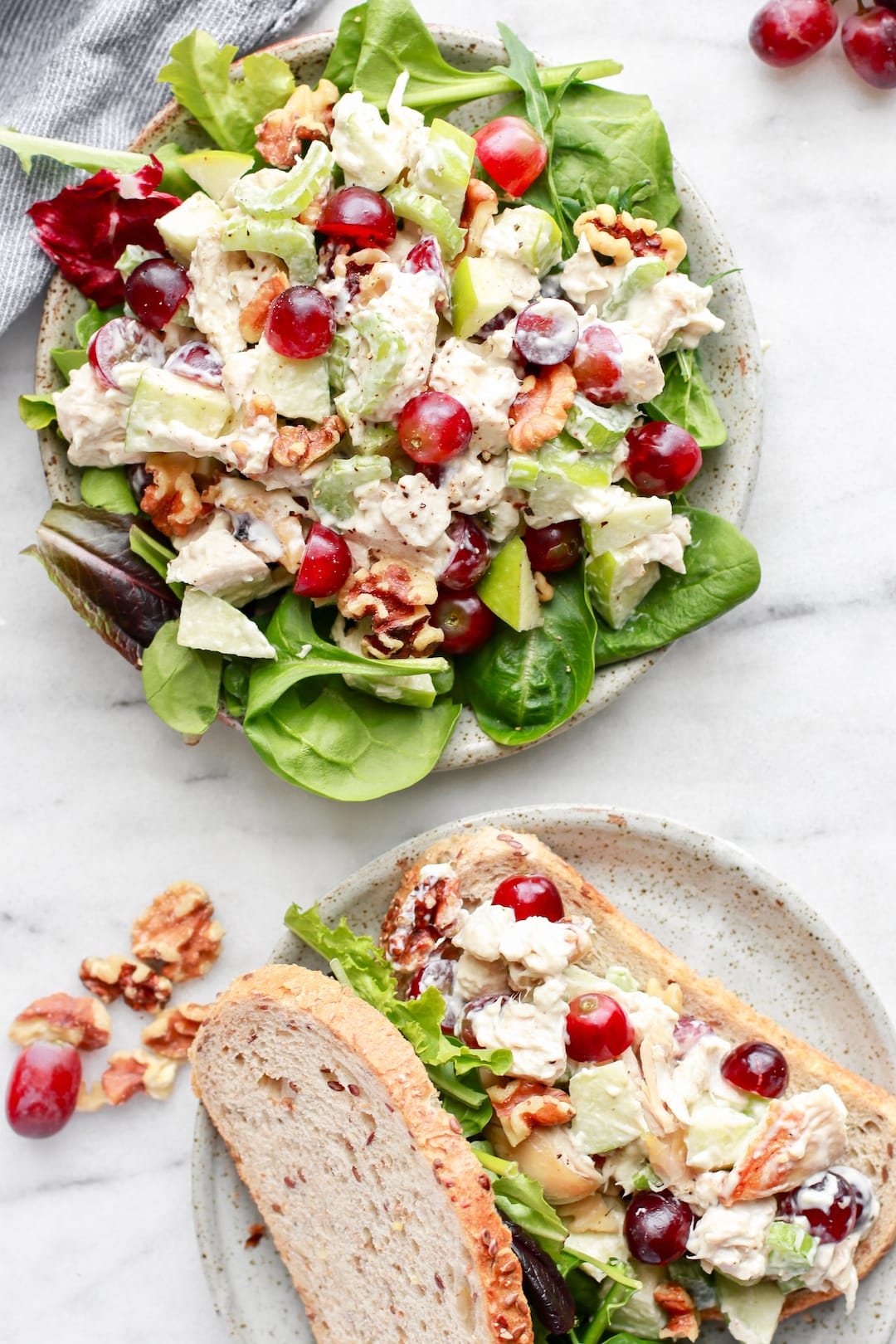 chicken salad with grapes and lettuce on a large plate