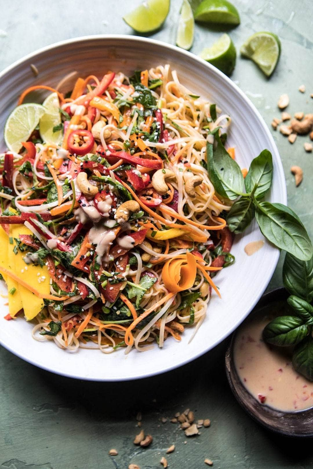 rainbow vegetable and noodle salad in a large bowl