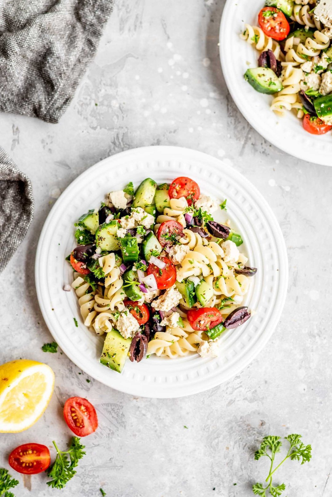 greek pasta salad on a white plate