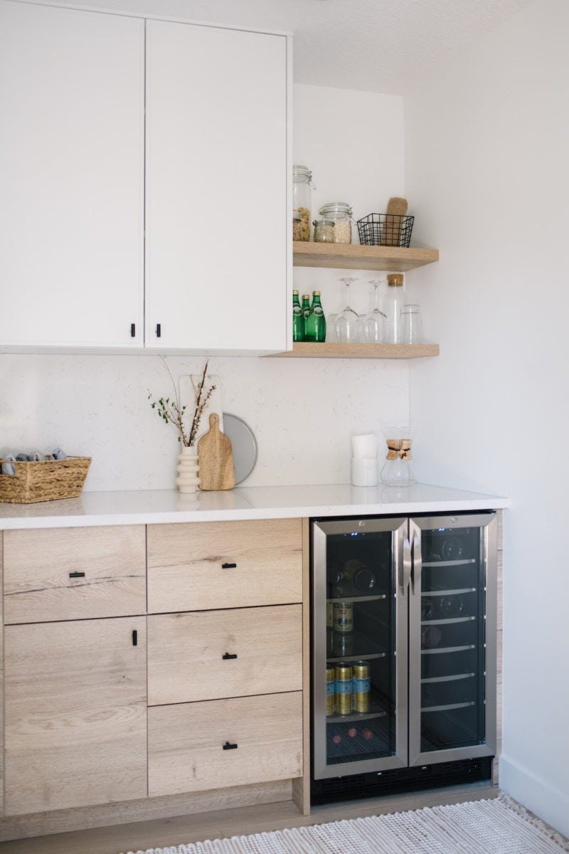 butlers pantry with wood and white cabinets