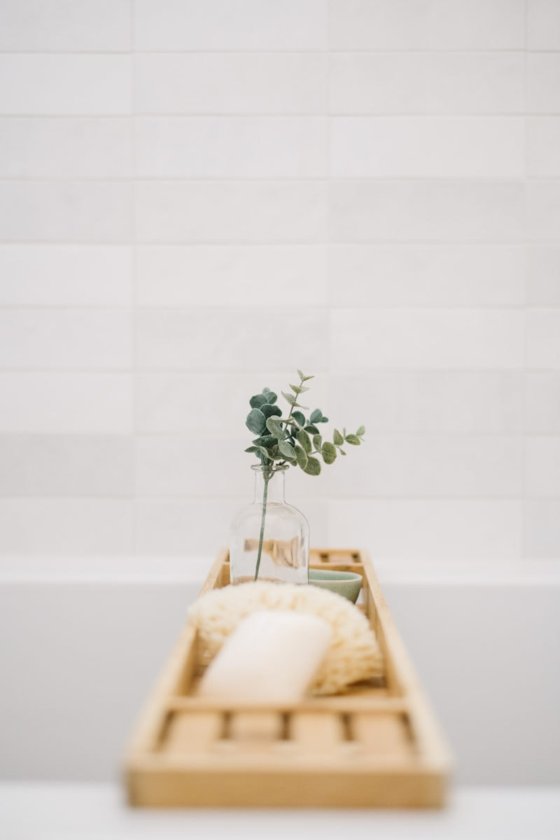 bathtub caddy with earthy decor