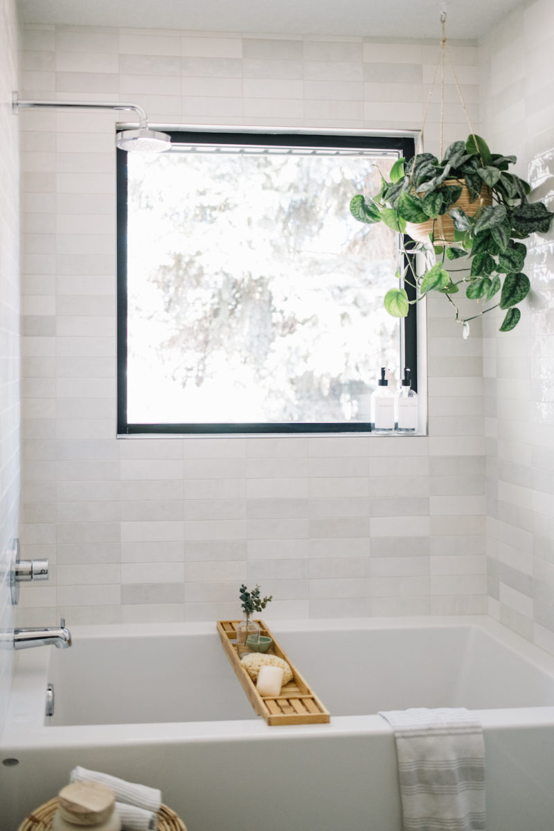 bathroom with light grey artisan tile and hanging plant