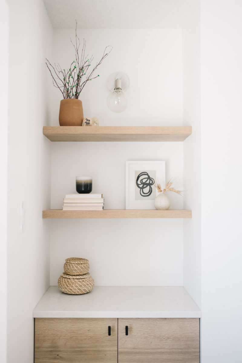 natural wood floating shelves with neutral decor