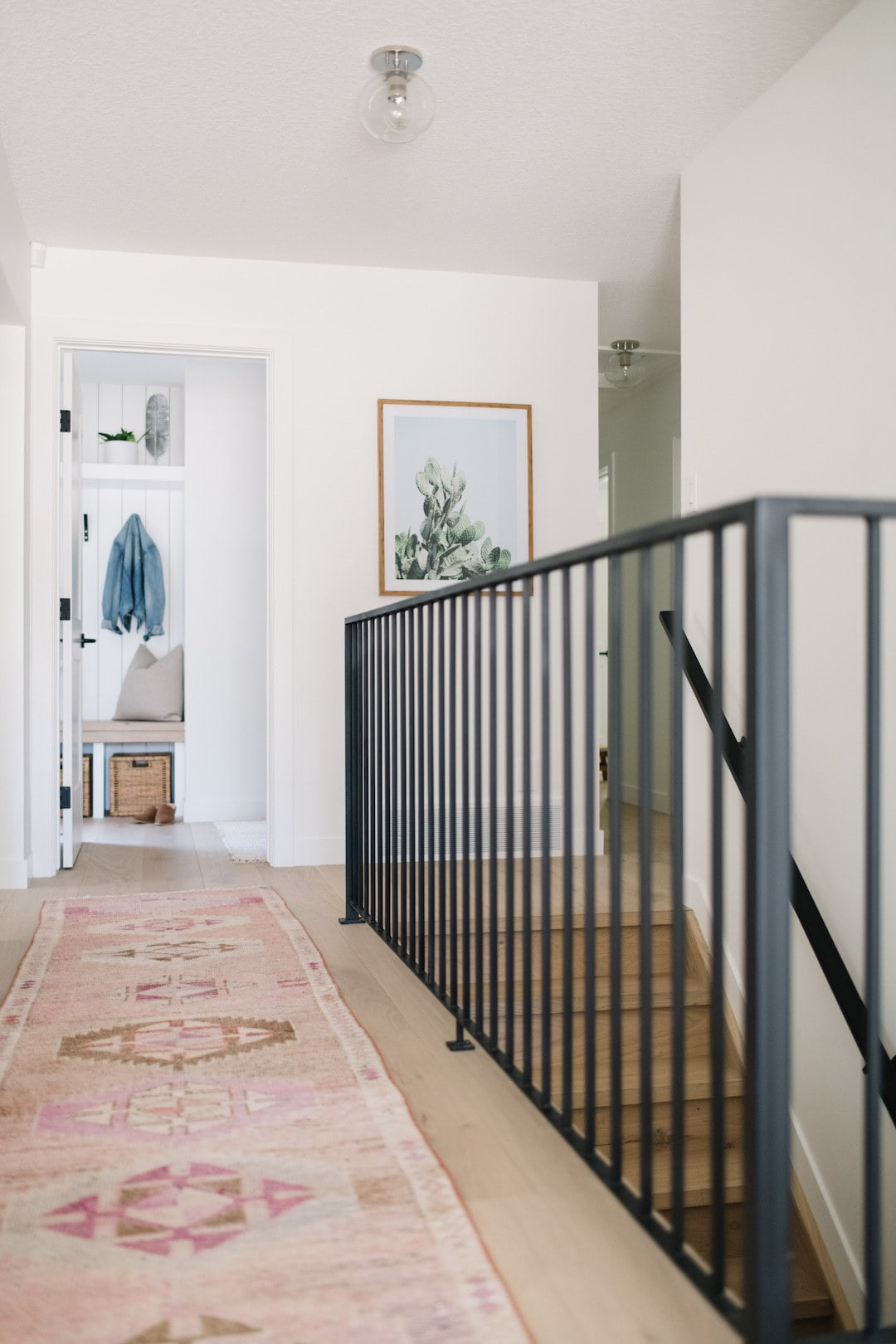 hallway with black iron modern railing