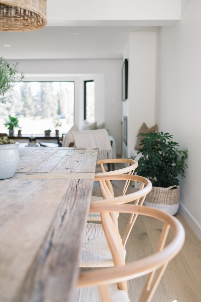 wishbone chairs at a wood table