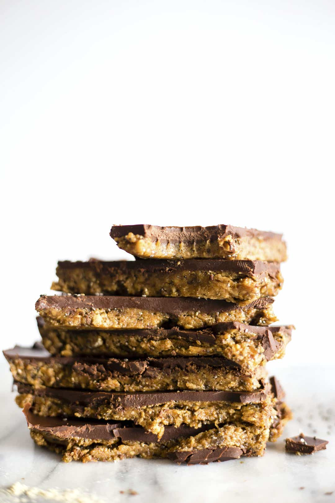 stack of almond butter paleo protein bars with chocolate