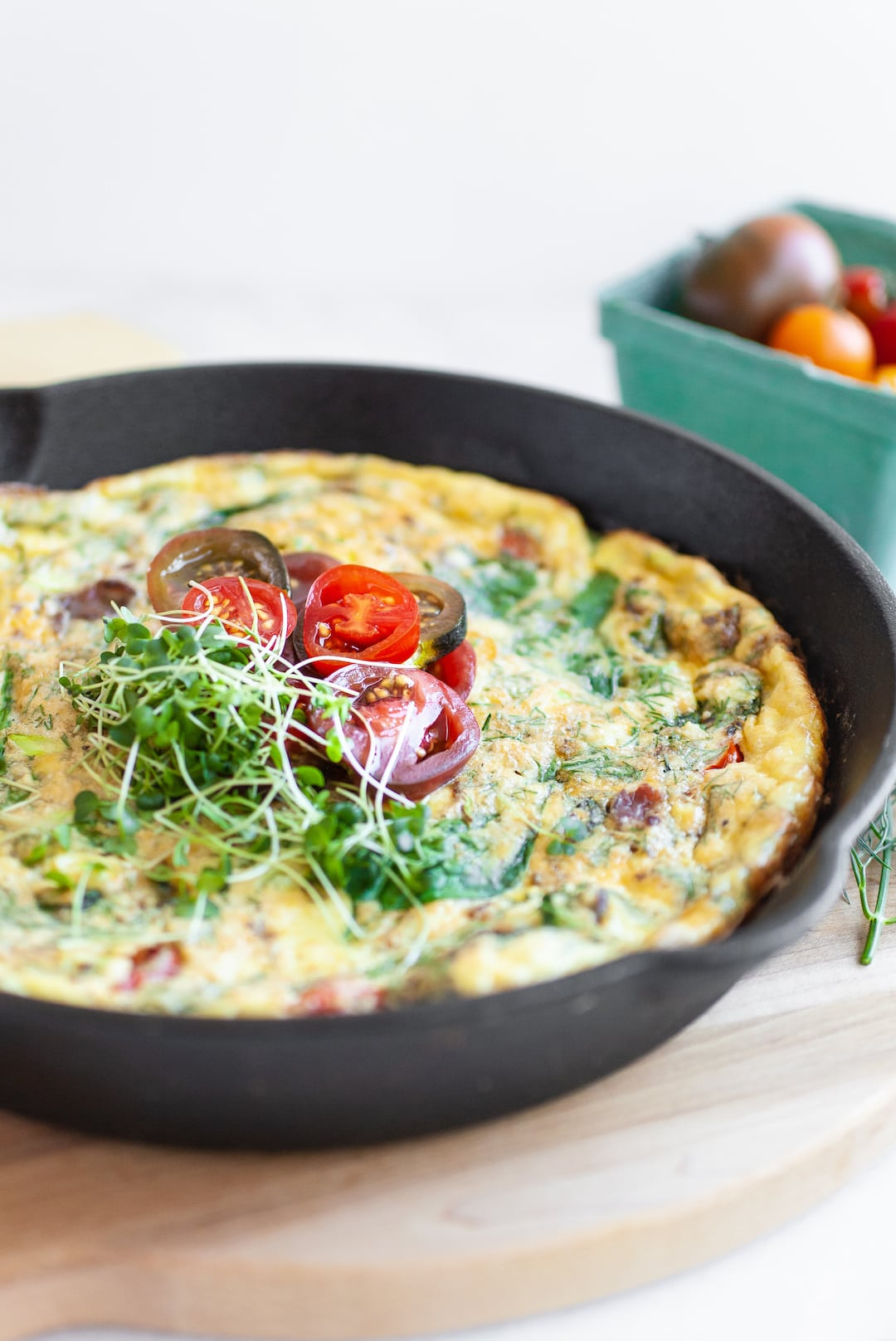 Side view of baked dairy free frittata in a skillet
