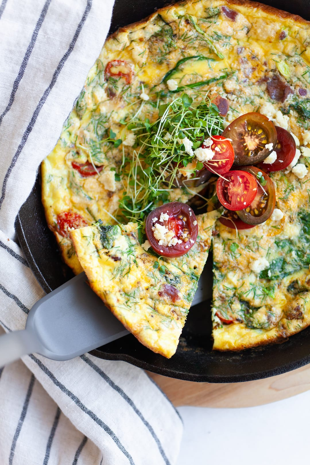 Slice of dairy free frittata in a skillet