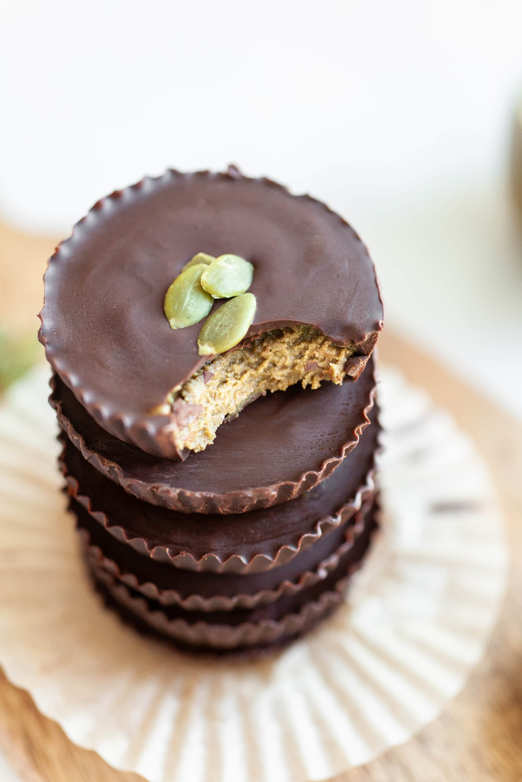 close up of chocolate pumpkin seed butter cups