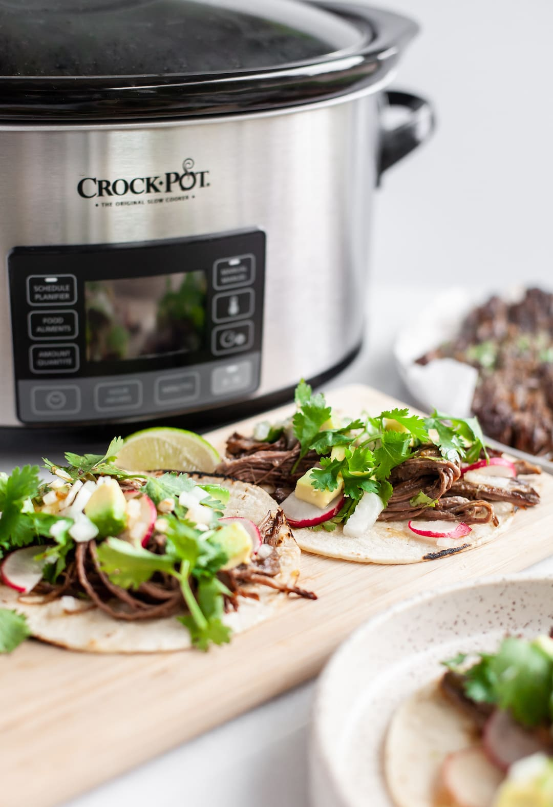 Crockpot with Carne Asada Tacos on a wood try