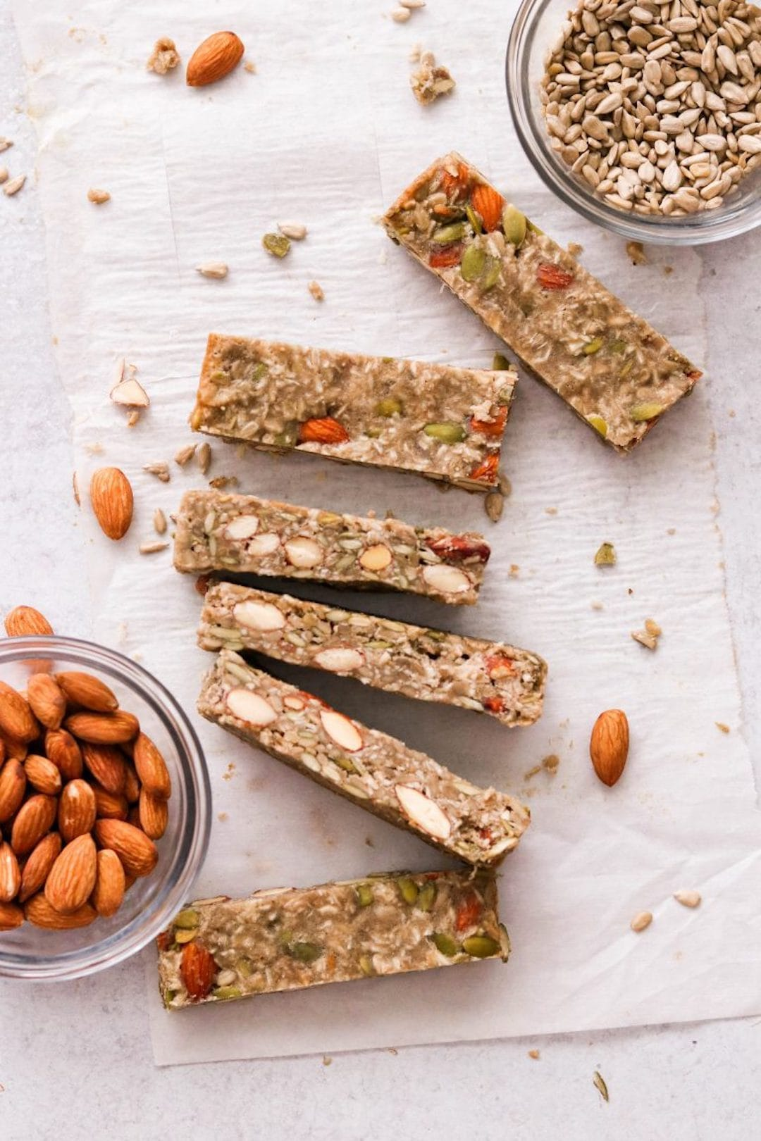 paleo protein bars on a tray with almonds