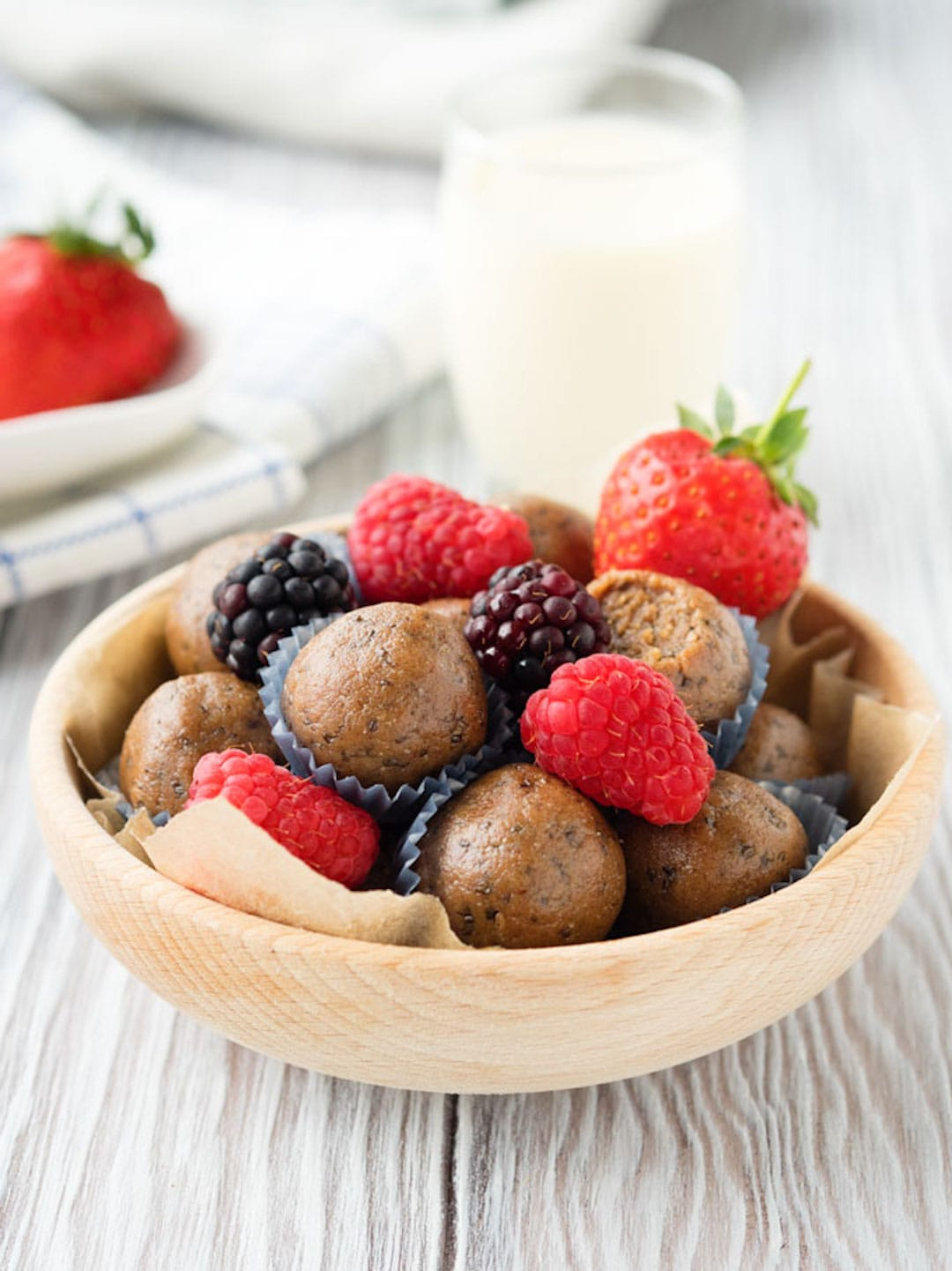 protein ball in a bowl with berries