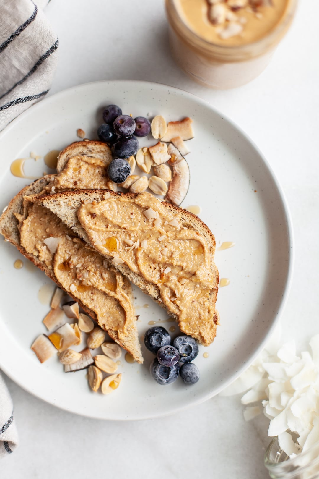 Toast topped with coconut peanut butter and blueberries