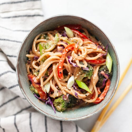 Peanut sauce noodle stir fry with vegetables in a bowl
