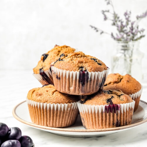 Fluffy Almond Flour Blueberry Muffins stacked on a plate