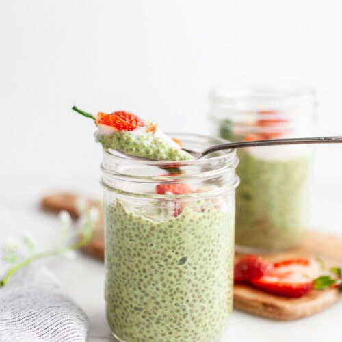 Spoon taking a scoop of Easy Matcha Chia Pudding out of a jar
