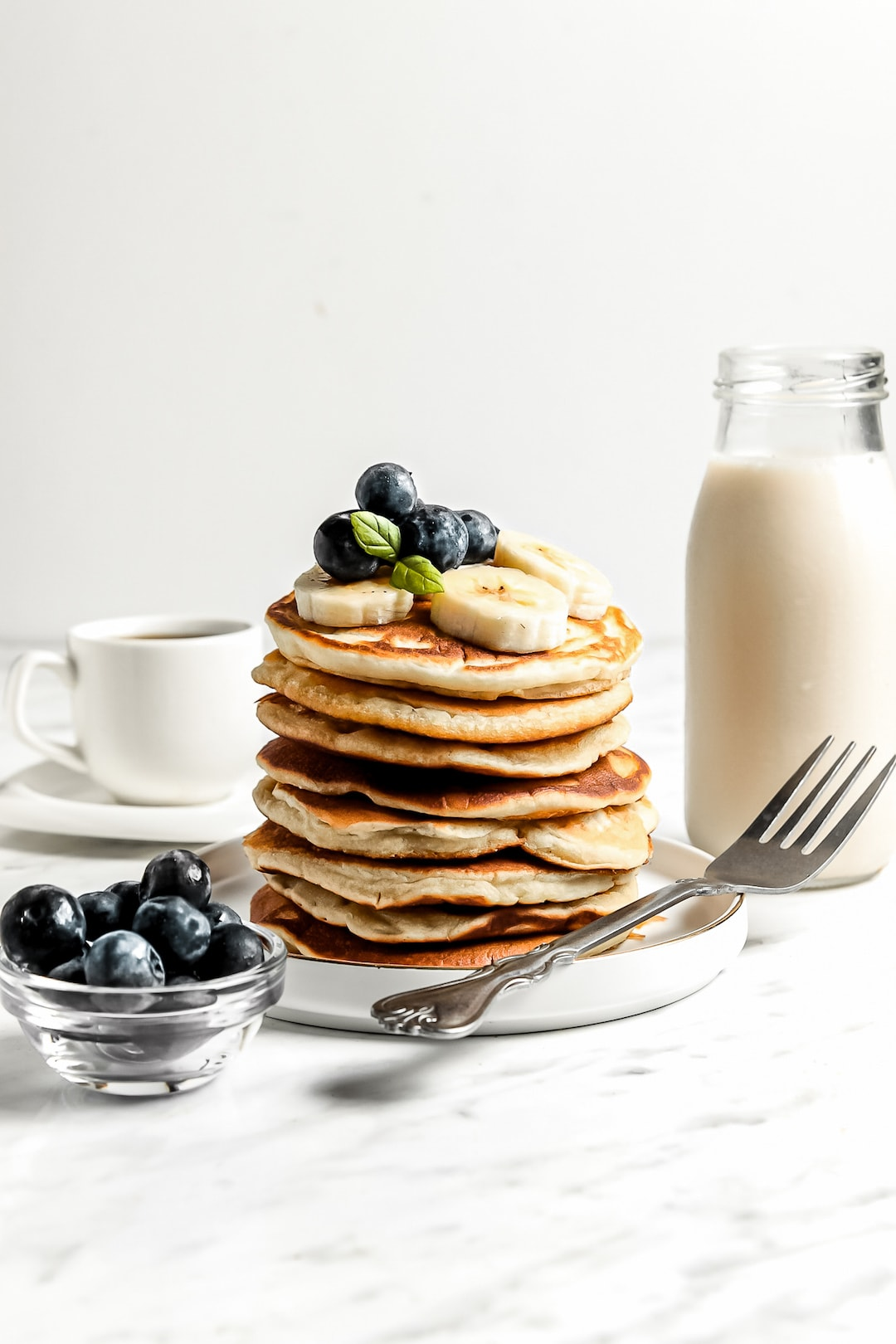 Healthy Cassava Flour Pancakes stacked with blueberries and banana
