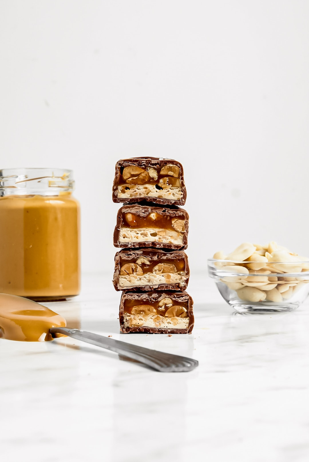 Stack of Must-Make Healthy 'Snickers' Protein Bar with peanut butter