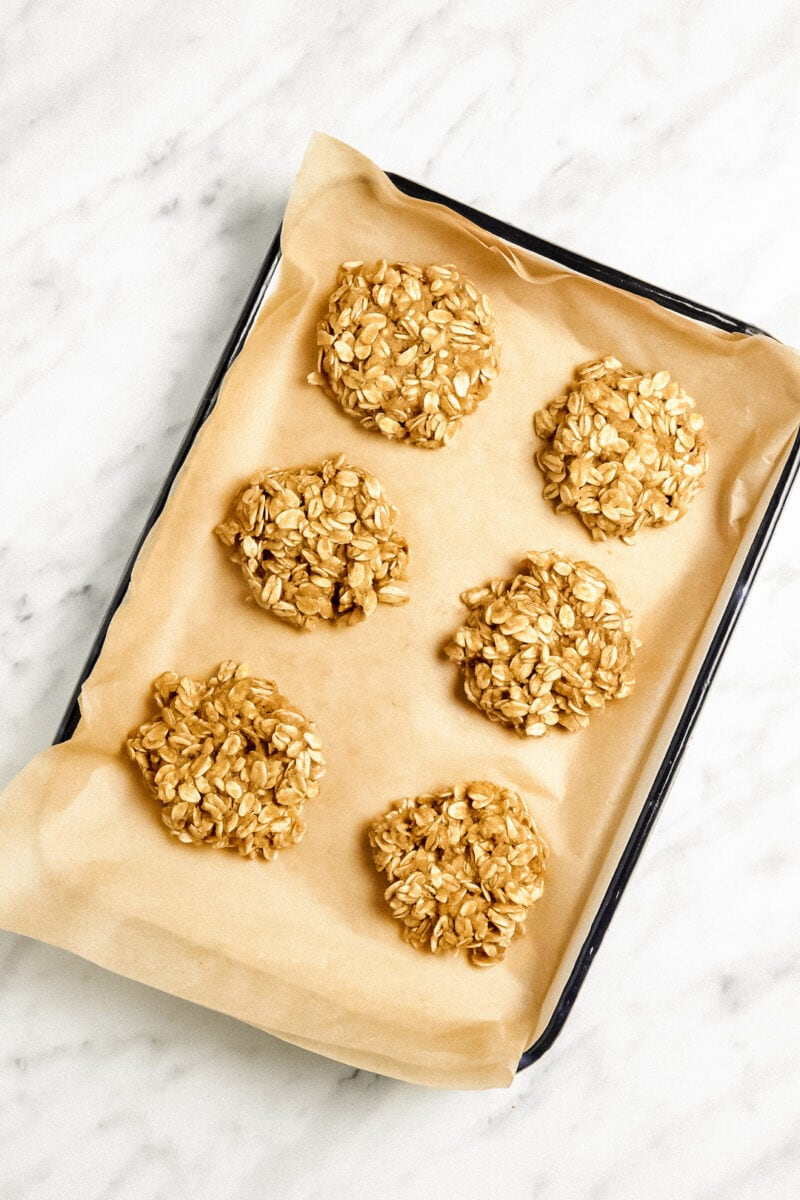 Unbaked Soft Healthy Almond Flour Oatmeal Cookies on a baking tray