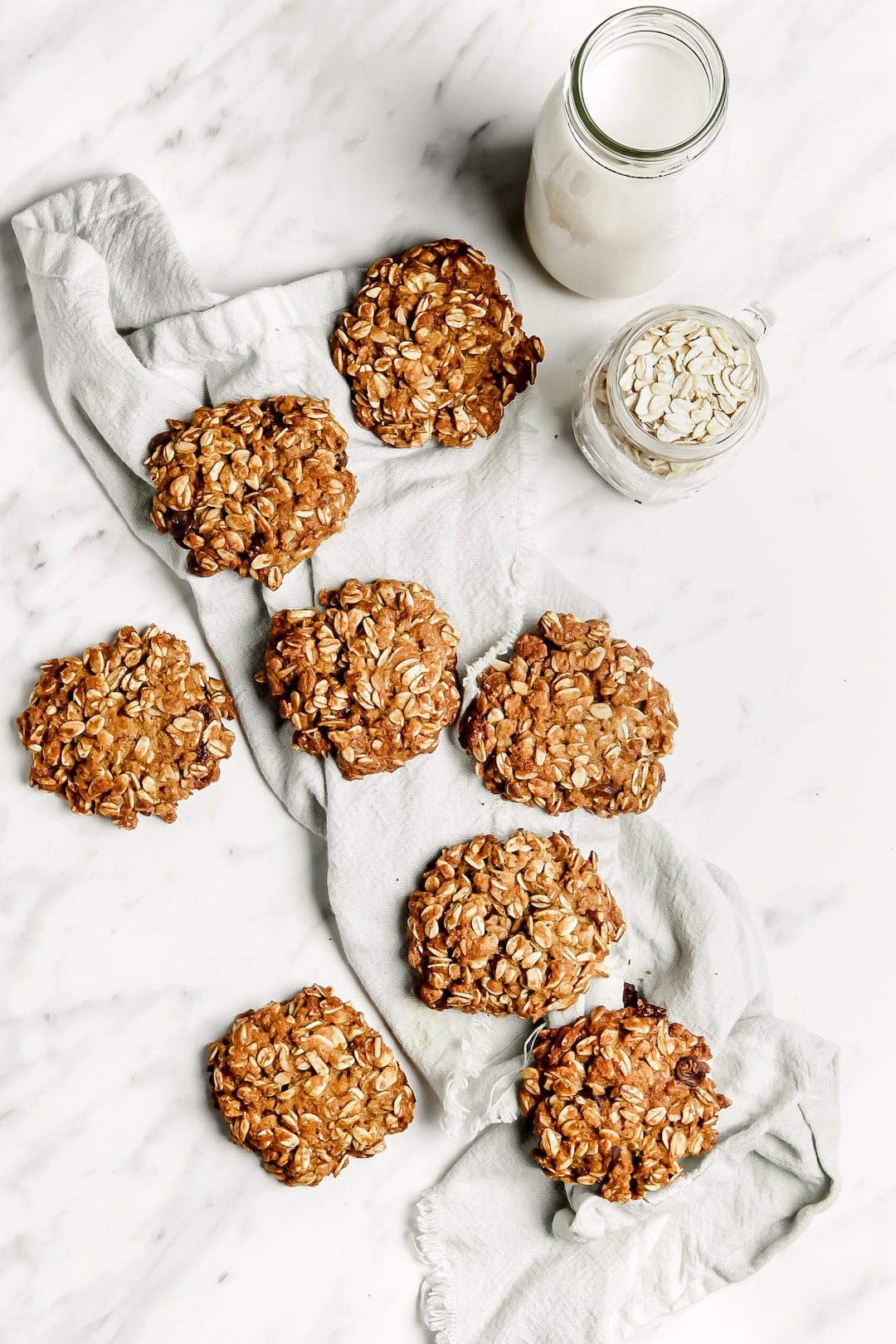 Soft Healthy Almond Flour Oatmeal Cookies on a marble board with tea towel