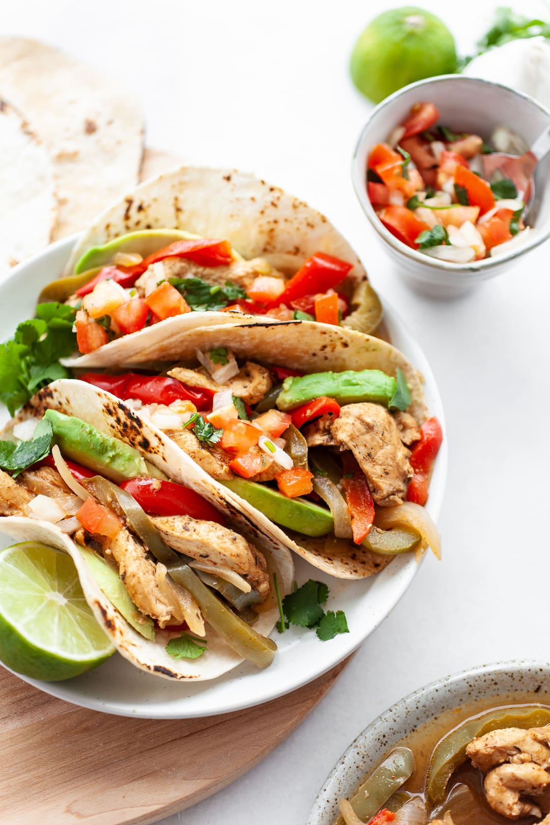 Instant Pot Chicken Fajitas on a plate with fresh salsa and avocado