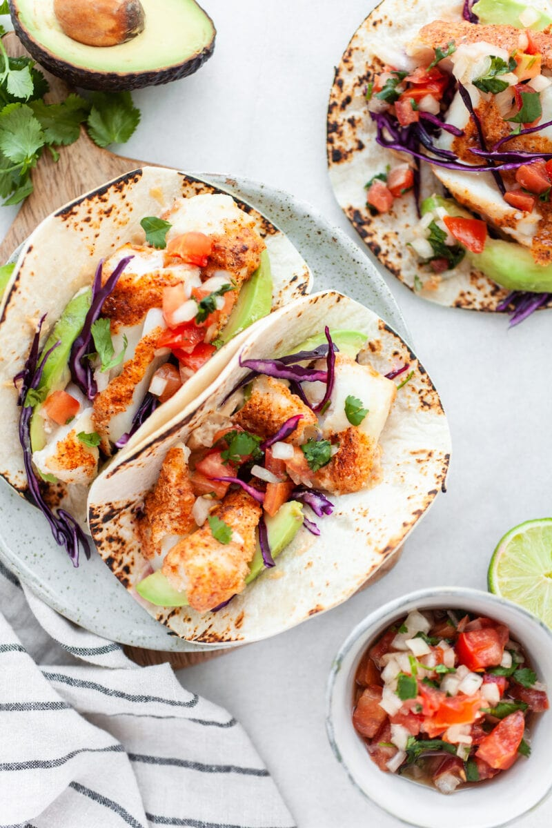 Healthy Air Fryer Fish Tacos with fresh salsa and cabbage