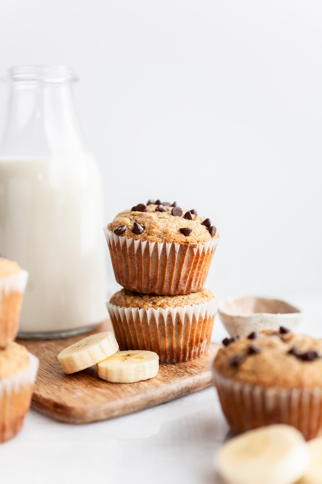 Stack of two Easy Almond Flour Banana Muffins with chocolate chips