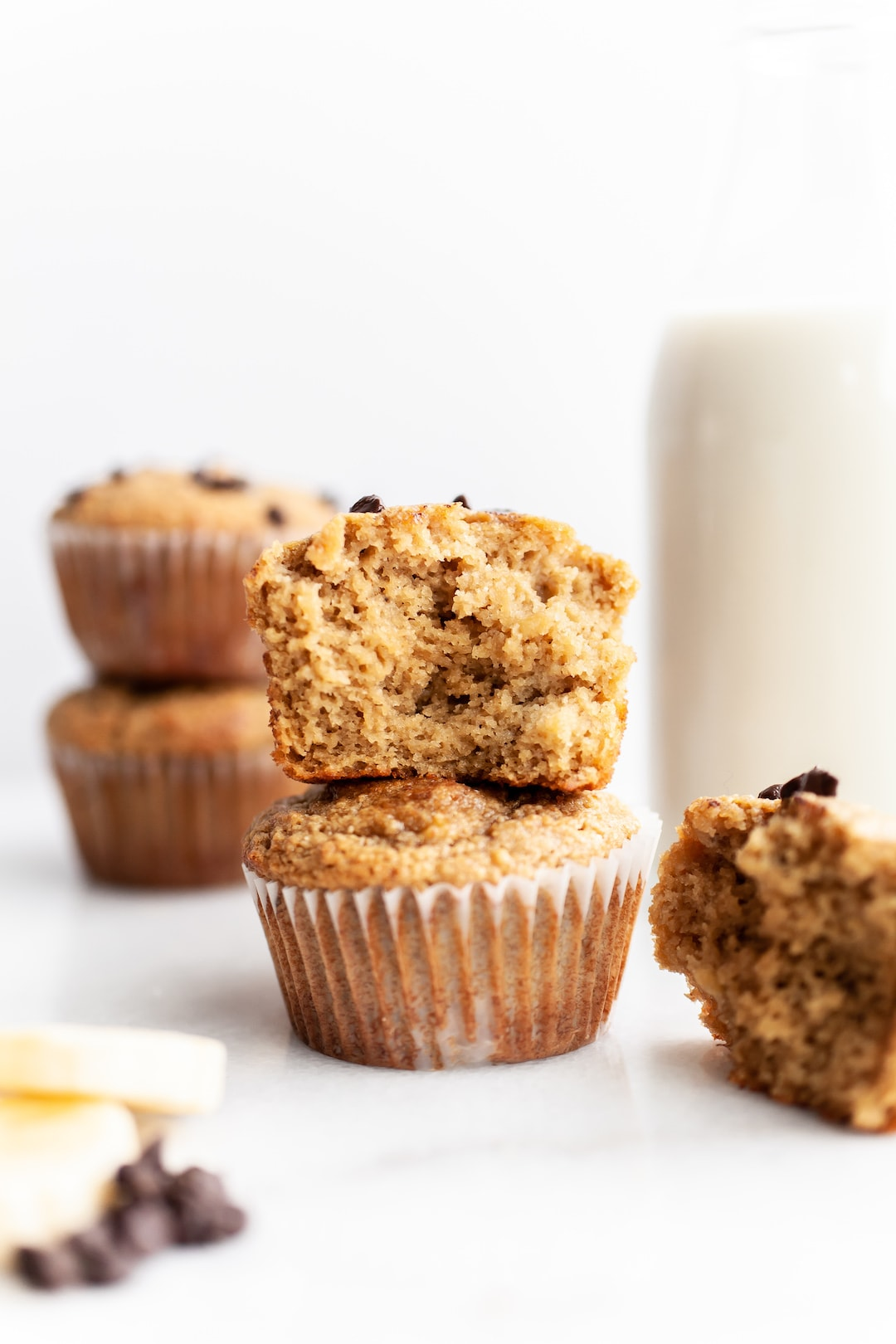 Close up of stack of two Easy Almond Flour Banana Muffins with one half eaten