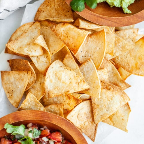 Platter of air fryer tortilla chips with guacamole and salsa