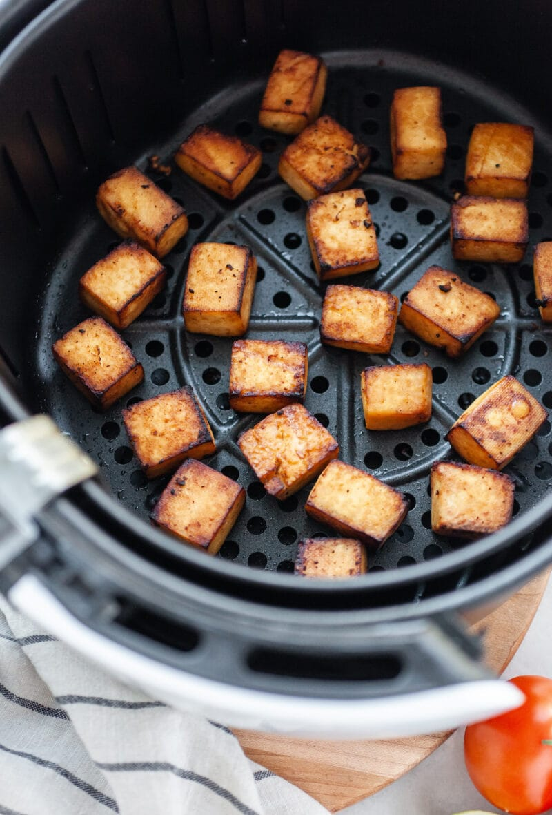 Cooked Crispy Air Fryer Tofu in the air fryer basket