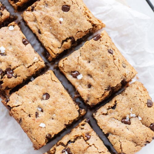 Best FUDGY Vegan Blondies cut into squares on parchment paper